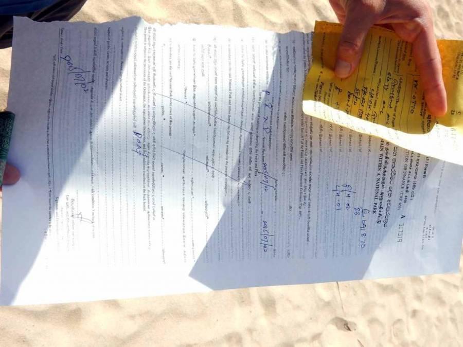 Sri Lanka | Viel Papierkram und ein recht unhandliches Ticket am Eingang zum Pigeon Island Nationalpark bei der Tour zum Tauchen oder Schnorcheln