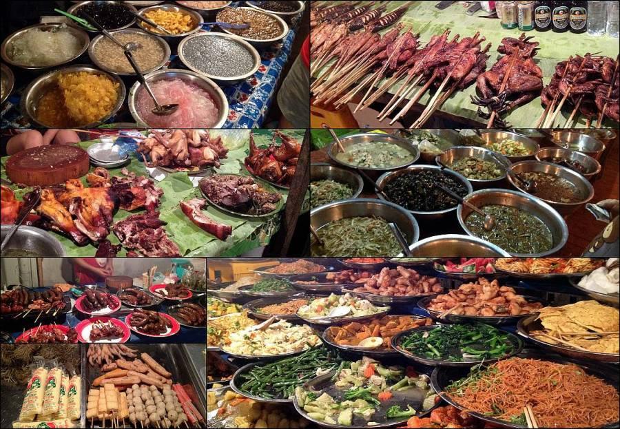 Buffetessen auf dem Nachtmarkt in Luang Prabang. Verschiedene Speisen von Salaten über Würstchen bis hin zu Fleisch und Dingen die man nicht identifizieren kann