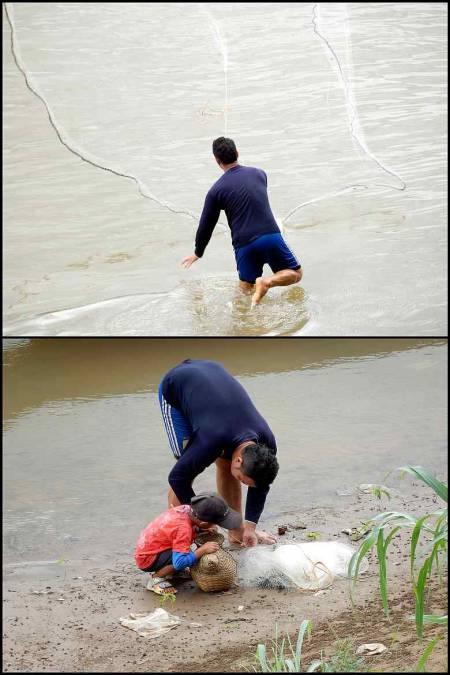 Ein paar mit seinem Sohn beim Fischfang in Laos