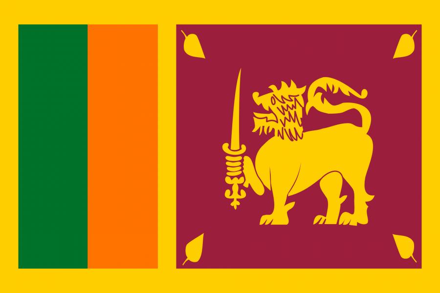 Sri Lanka Reise- und Länderinformation. Sri Lanka Flagge. Gelb, rot, orange, grün mit einem gelben Löwen in der Mitte, der ein Schwert hält