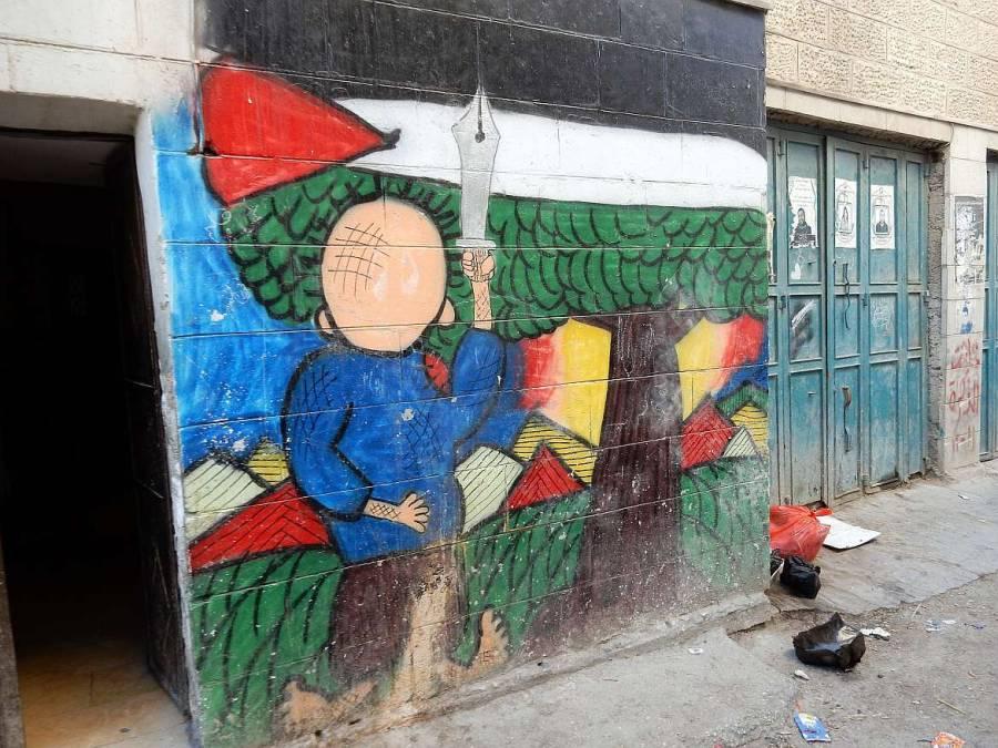 Graffiti Mann mit Schwert vor palästinensicher Flagge im Aida-Flüchtlingscamp in Bethlehem