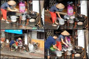 Vietnam | Norden, Hanoi an den Bahngleisen. Kochen vietnamesischer Art. Mehrere Töpfe brodeln auf verschiedenen Feierstellen und ein Mann und eine Frau bereiten ihr Mittagessen