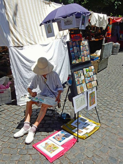 Argentinien | Buenos Aires, Künstler mit Sonnenhut auf dem Markt in San Telmo