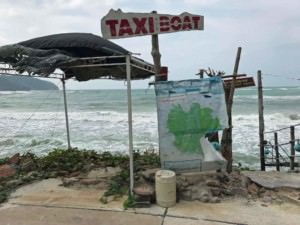 Thailand,Taxi Boot-Station auf Koh Phangan am Chaloklum Strand. Blick auf ein Taxi-Boat Schild vor dem Meer