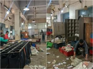Die Post in Indien: hier das Postamt in Agra. Mann sortiert Briefe auf dem Boden