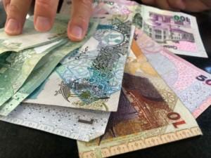 Tipps zum Bargeld abheben: Die Währung von Katar sind der Qatar Riyal (QAR)